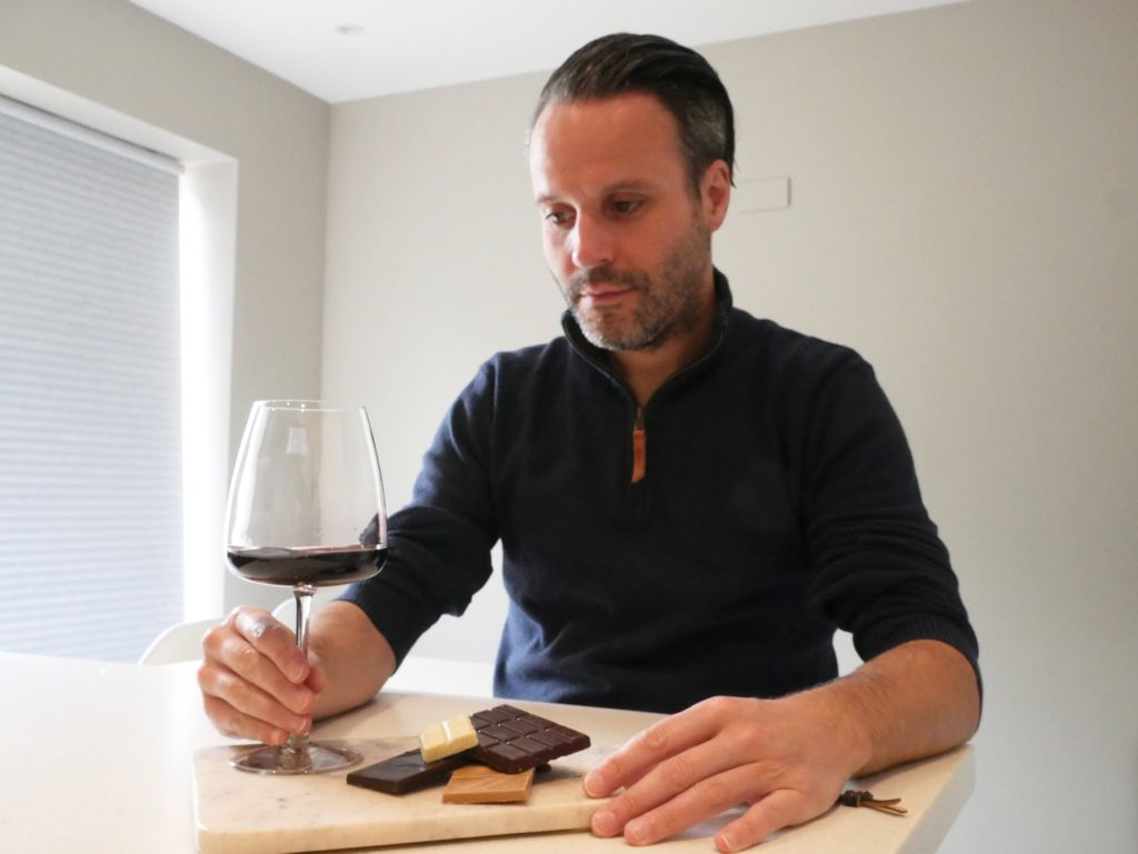 Sommelier Marco tries a glass of red wine and chocolate