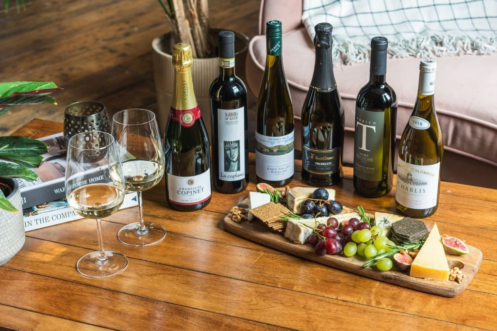 The Club Vino Mixed Collection alongside a section of cheeses. Delicious food and wine pairings.